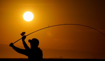 Record heat. A fisherman casts into the surf Tuesday, May 5, 2020, in Huntington Beach, California after a heat wave.