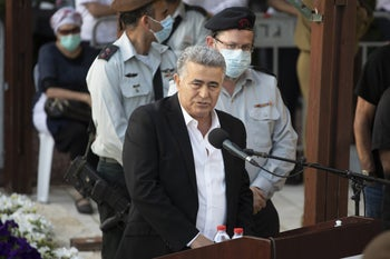Economy and Industry Minister Amir Peretz speaking at a ceremony in May 2020.