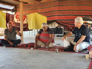 Salman Abu Hamid and Salim Danifri, two leaders of the Bedouin community of Bir Hadaj, explain their version of events to visiting activists, including Shuli Dichter (right), June 12, 2020.