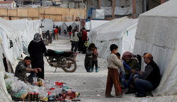 Internally displaced Syrians are seen in an IDP camp in a sports stadium in Idlib, Syria February 27, 2020.