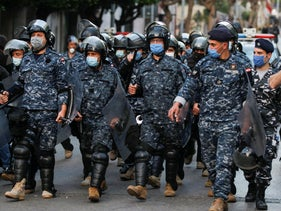 File photo: Lebanese police wear face masks as they walk together during a protest in Beirut, Lebanon April 23, 2020.