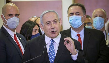 Netanyahu delivers a statement before entering the district court in Jerusalem on the first day of his trial, on Sunday, May 24, 2020.