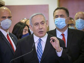 Netanyahu delivers a statement before entering the district court in Jerusalem on thefirst day of his trial, on Sunday, May 24, 2020.