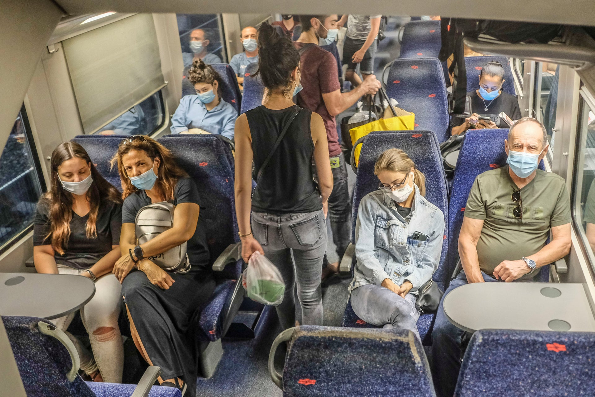 Israelis on a newly functioning train, on June 22, 2020.