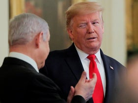 U.S. President Donald Trump winks at Netanyahu during a joint news conference in the East Room of the White House in Washington, U.S., January 28, 2020.