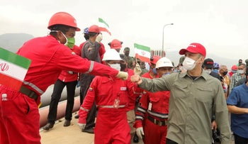 """A worker of the state-oil company Pdvsa greets Venezuela's Oil Minister during the arrival of the Iranian tanker ship """"Fortune"""" at El Palito refinery in Puerto Cabello, Venezuela on May 25, 2020."""