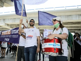 A protest march by social workers in Holon, central Israel, June 24, 2020.