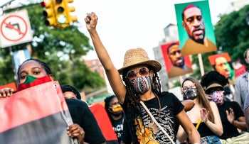 People participate in a march in Brooklyn for Black Lives Matter and to commemorate the 155th anniversary of Juneteenth on June 19, 2020 in New York City