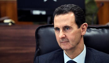 In this Jan. 7, 2020, file photo, Syrian President Bashar Assad listens to Russian President Vladimir Putin during their meeting in Damascus, Syria. The Trump administration is ramping up pressure on Syrian President Bashar Assad and his inner circle with a raft of new economic and travel sanctions for human rights abuses.