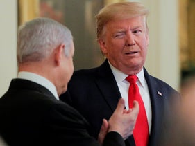 Trump winks at Netanyahu as they discuss the Middle East peace plan proposal during a joint news conference in Washington, U.S., January 28, 2020