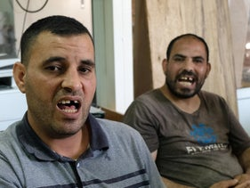 Moussa, left, and Issa Ktash. The two still wake up in fright at night, and their children, who saw them returning bruised and bleeding, are haunted by the images.