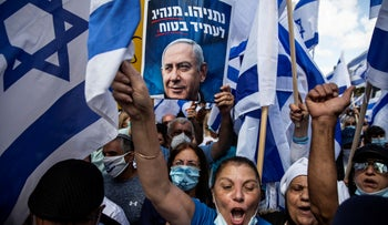 Supporters of Prime Minister Benjamin Netanyahu take part in a protest outside the Prime Minister's residence, on the day when Netanyahu's corruption trial started, Jerusalem, May 24, 2020