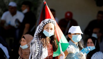 Palestinians take part in a protest against Israel's plan to annex parts of the West Bank, in Bardala in the northern Jordan Valley, June 27, 2020.