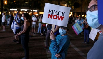 A demonstrator holds a sign during a protest against Israel's planned annexation of parts of the occupied West Bank, Tel Aviv, June 23, 2020.