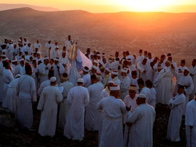 Samaritans gather to pray on top of Mount Gerizim near the northern West Bank city of Nablus as they celebrate the Shavuot festival at dawn, June 28, 2020.