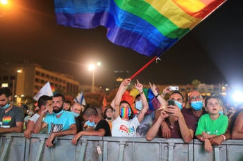 Hundreds of LGBT members and supporters attend a gay pride rally under strict health restrictions due to the coronavirus outbreak in Tel Aviv, Israel, Sunday, June 28, 2020.