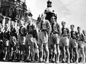 Members of the Hitler Youth marching in 1936. Carl Schmitt used the group as an example for Nazi legal theory.