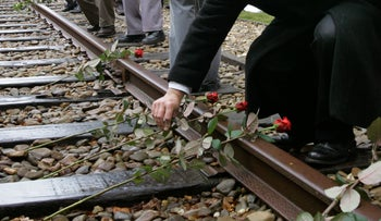 File photo: Roses are symbolically placed on the railroad tracks at former concentration camp Westerbork, the Netherlands, May 9, 2015.