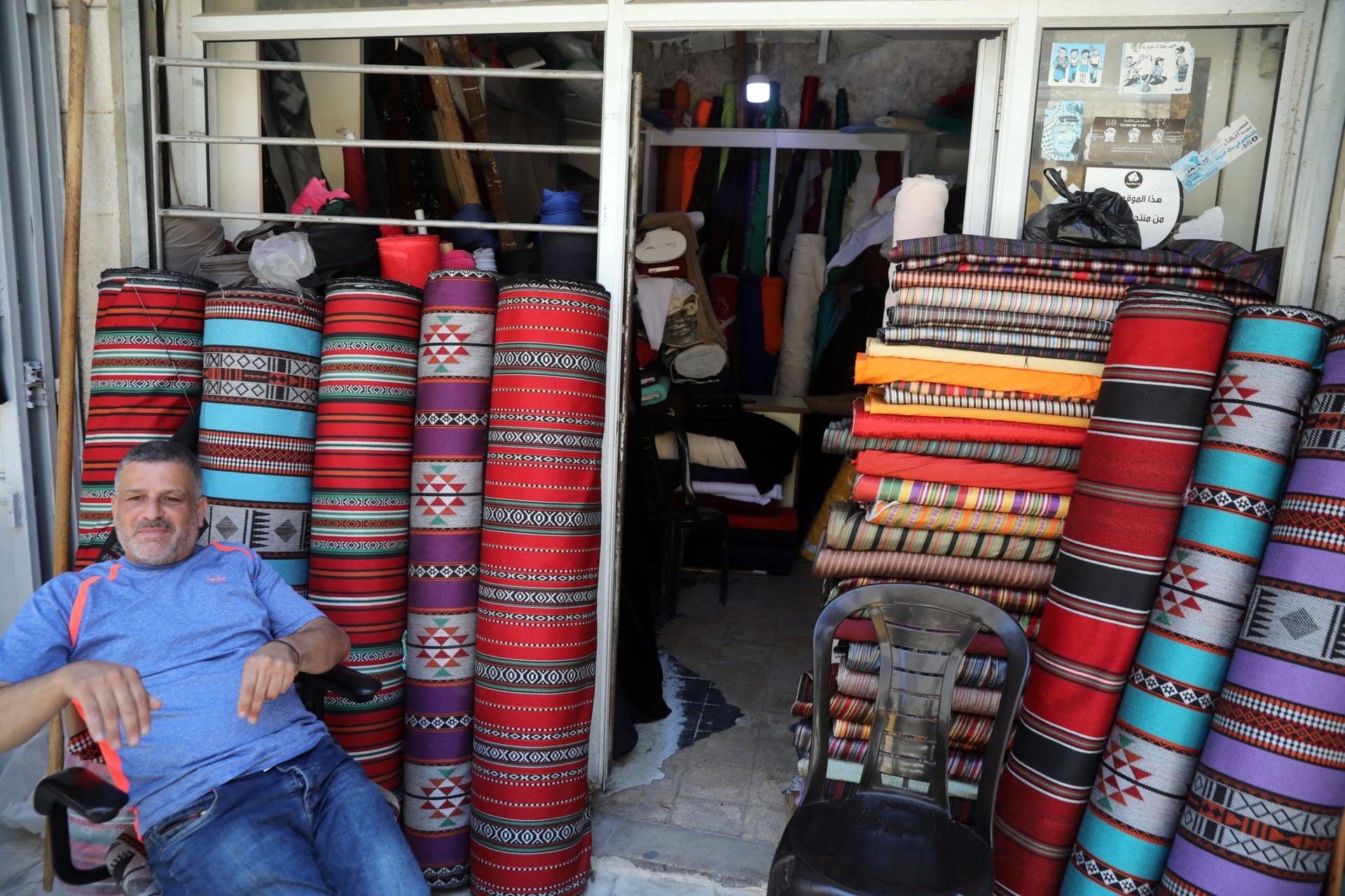 "Assem Barakat at his carpet store in Bethlehem. ""We're not worried about annexation. It's just Netanyahu's latest crazy idea, but it's not a solution for anyone – not even the Israelis."""