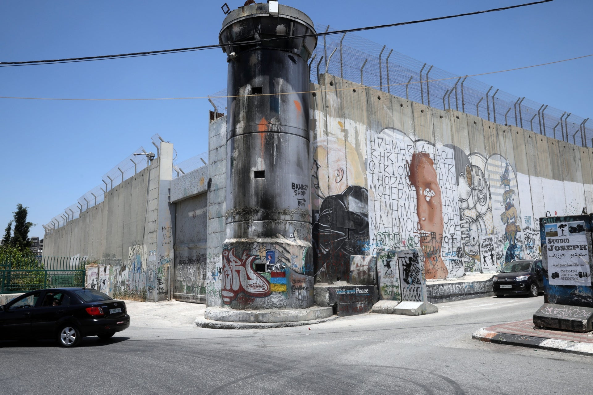 "The West Bank separation barrier in Bethlehem. ""Israeli business is what could save Bethlehem, if only there was no wall."""