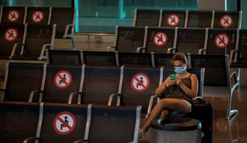 A passenger sits at Barcelona airport in Barcelona, Spain, June 30, 2020.