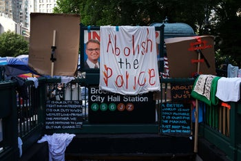 Protesters camped outside of City Hall in Lower Manhattan demand that the New York City Police Department (NYPD) be defunded, New York City, June 30, 2020.