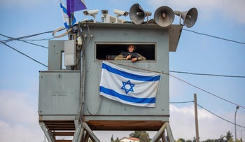An Israeli soldier stands guard at the Tapuach junction next to the West Bank city of Nablus, June 30, 2020.