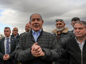 Netanyahu gives a statement during a visit to Jordan Valley, February 2020. Behind him, to his left, Yesha Council of Settlement head David Elhayani.