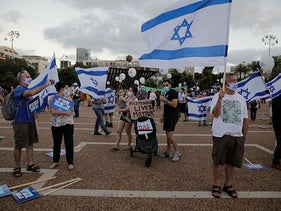 People take part in a protest against Israel's plan to annex parts of the West Bank and Trump's mideast initiative, in Tel Aviv, Israel, June 23, 2020.