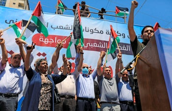 Hamas leader Yahya Sinwar (4th L) takes part in a rally against annexation in Gaza City on July 1, 2020.