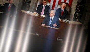The lights of the House Chamber are reflected in the railing that surrounds the chamber on Capitol Hill in Washington, March 3, 2015, as Benjamin Netanyahu speaks before a joint meeting of Congress.