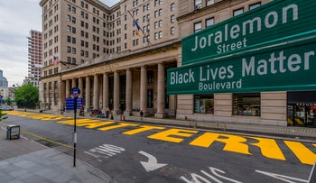 A massive 'Black Lives Matter' mural painted in large yellow letters outside of Brooklyn's Borough Hall, June 27, 2020.