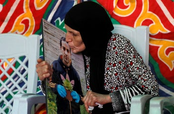 Eyad Hallaq's mother holding his picture while she mourns her son, East Jerusalem.