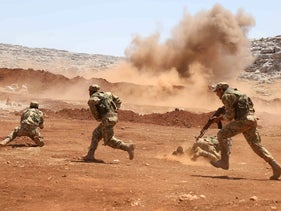 Members of Syria's opposition National Liberation Front take part in a military training in the northern countryside of Idlib province, on July 1, 2020.
