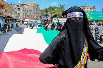 Palestinians rally against Israel's West Bank annexation plans, in Rafah in the southern Gaza Strip on June 29, 2020.