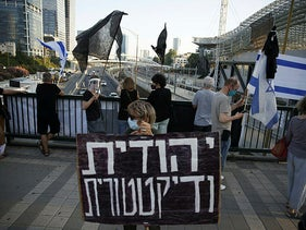 'Blag Flag' protesters on a bridge above a major highway in Tel Aviv, July 4, 2020.