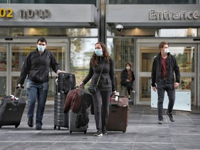 Israelis leaving Ben Gurion Airport after arriving from the United States, April 11, 2020. Israelis living overseas with nonnational partners haven't been so lucky.