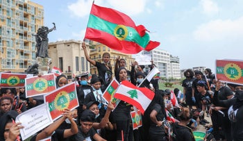 Members of the Oromo Ethiopian community in Lebanon take part in a demonstration to protest the death of musician and activist Hachalu Hundessa, in the capital of Beirut, July 5, 2020.