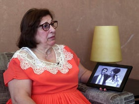 Laure Ghosn, whose husband Charbel Zogheib has been missing for the past 37 years, speaks as she holds their wedding portrait during an interview at her home in Sarba, north of Beirut, June 26, 2020.