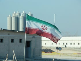 An Iranian flag flutters at Iran's Bushehr nuclear power plant, November 2019.