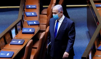 Netanyahu wears a mask at the Knesset, Israel's parliament, in Jerusalem, on May 17, 2020.