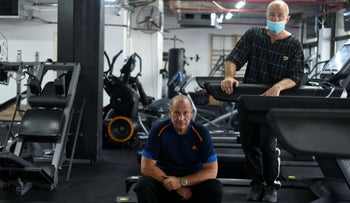 Gerik Stolin and Alexander Stoknov put the equipment from their gym in Kiryat Shmona into a warehouse because they can no longer afford the businesses' rent, July 7, 2020