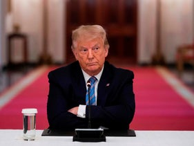 Donald Trump sits during a discussion on the reopening schools, at the White House on July 7, 2020.