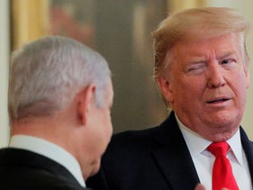 Trump winks at Netanyahu during a joint news conference at the White House, January 28, 2020.