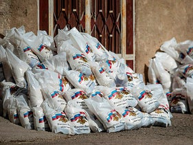 Bags of Russian humanitarian aid are seen laying on the ground, after residents refused to accept them, in the town of Derouna Arha near the Syrian border with Turkey, June 16, 2020.