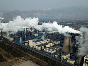 Smoke and steam rise from a coal processing plant in Hejin in central China's Shanxi Province, November 28, 2019.