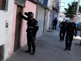 Police conduct a raid to uncover brothels in Tel Aviv in March, 2020.