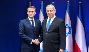 Netanyahu shakes hands with French President Emmanuel Macron during his visit to Israel to take part to a Holocaust memorial event in January 2020.