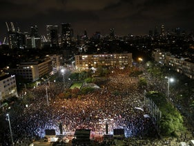 Ten thousand Israelis gathered at Rabin Square in Tel Aviv to protest government mismanagement of economic crisis caused by the coronavirus, July 11, 2020