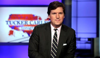"""In this March 2, 2017 file photo, Tucker Carlson, host of """"Tucker Carlson Tonight,"""" poses for photos in a Fox News Channel studio, in New York"""